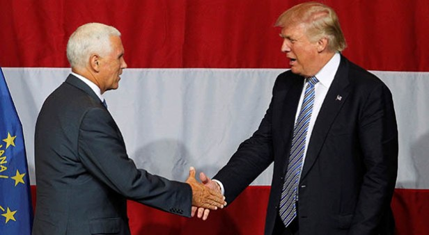 Republican U.S. presidential candidate Donald Trump shakes hands with Indiana Governor Mike Pence before addressing the crowd during a campaign stop at the Grand Park Events Center in Westfield